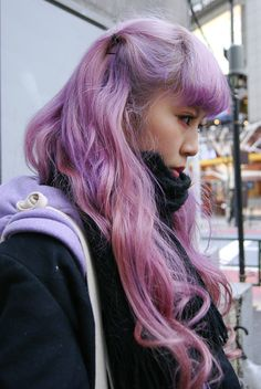 Her eyeliner matches her hair. c: