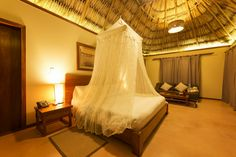 El Secreto - Belize Idyllically located on...Idyllically located on Belize's majestic Ambergris Caye, El Secreto is a stunning collection of 13 thatched roof villas nestled by the stunning shores of the western Caribbean Sea. by Luxury Accommodations