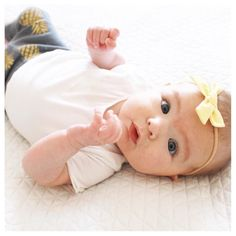 [Happy Friday Instababes! It doesn't get much cuter than baby Elke in our new yellow bow ]