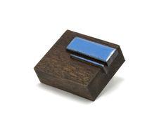 "Julia Turner ""Blue Tab Brooch"", 2012. Wood, vitreous enamel on steel.  1.2 x 1 x .4 in (3 x 2.5 x 1 cm)."