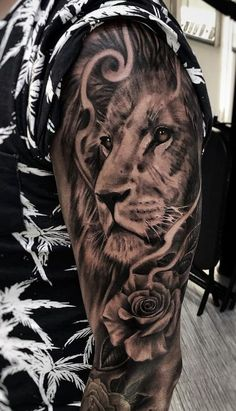 50 Eye-Catching Lion Tattoos That'll Make You Want To Get Inked beautiful black & gray lion tattoo © tattoo artist Emanuel Polo 📌💗🐵💗🐵💗🐵💗🐵💗📌 Lion Forearm Tattoos, Lion Head Tattoos, Leo Tattoos, Bicep Tattoo, Feather Tattoos, Couple Tattoos, Body Art Tattoos, Lion And Rose Tattoo, Rose Tattoos For Men