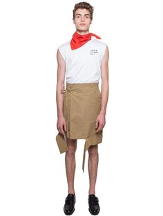 Sand beige cotton nylon blend asymmetrical short wrap kilt('skilt'), from Chin Mensfeaturing adouble button closurewith long string ties, belt loops,slashed hemline details, two front side pockets, and two back welt pockets.   Measurements: Item fits true to size. Model Measurements: Height (Cm): 189 Bust/Chest (Cm): 93 Waist (Cm): 72 Hips (Cm): 86 Model is wearing size: M  Item ID: CHM201701021 Composition: 68% Cotton, 32% Nylon WASHING INSTRUCTIONS: DRY CLEAN ONLY Ma...