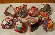 Ornaments crocheted or blanket-stitched together from old Christmas cards - I love these, and the baskets you see commonly made in the same style.