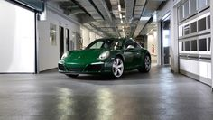 One-millionth 911 (Porsche 911 Carrera S, number 1,000,000, is painted in Irish Green, fitted with houndstooth pattern bucket seats, a wooden steering wheel, and, a manual gearbox with a wood-capped shifter - will tour the world before going into the Porsche museum).