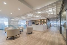Penguin Random House | Ceiling + Wall Feature // an undulating MDF bookshelf feature formed by 495 white boxes, climbs a 20 foot wall and flows 32 feet across the ceiling // Commercial Architecture Office Design Figure 3