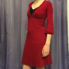 Red deep v-neck sweater dress This gorgeous red sweater dress with deep v-neck looks great with a cami or slip underneath. I have worn this a handful of times, and it's in great condition. The waist is about 24 inches unstretched but easily stretches to about 30 inches. Size S Wet Seal Dresses
