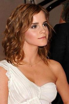 Emma looking great in a white dress...