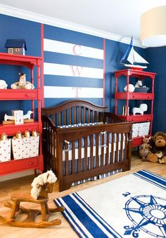 Nautical nursery design - love the vertical monogram over the striped wall!