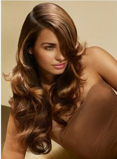 Deep side parts are so 2014! Smooth out your wavy locks with BASSU OIL for this glossy finish.