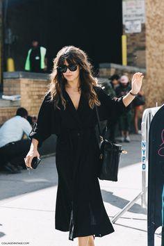 Miroslava Duma in a LBD with an Hermes bag, classic Ray-Bans, and good hair.