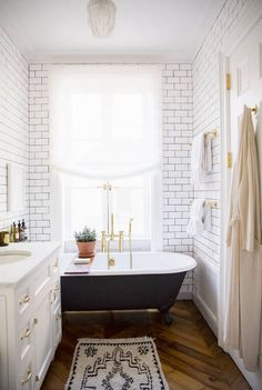 Love brass hardware with the subway tile and dark grout
