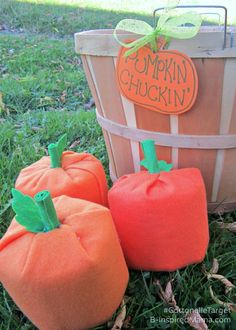 Can you guess what simple household item we used to make this fun Pumpkin Chuckin' Halloween Game for the kids Halloween Party?!