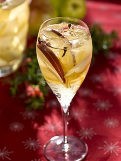 Autumn Sangria. Would be great for Thanksgiving! 1 bottle chilled dry white wine, I bottle chilled champagne, 3 oz. Damiana liqueur (herbal liqueur with citrus and vanilla flavors), 2 freshly sliced pears, 2 apples, 20 whole cloves, 1 tsp. ground nutmeg.