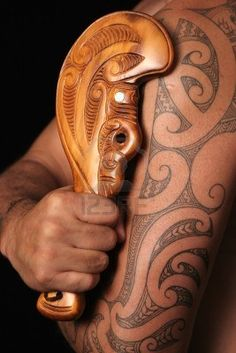 Close up of maori tamoko tribal tattoo and carved wooden mere club #samoan #tattoo