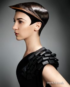 2012 graphic cropped hair, hairstyle, future, futuristic look, future fashion, unique hair, black clothes, model, fashion girl by FuturisticNews.com