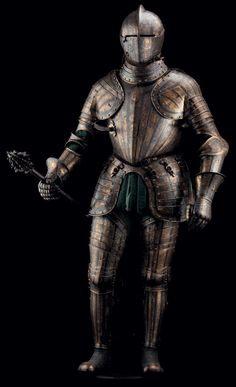 An exceptional North Italian etched blued and gilt full armour for the field, signed POMPE and attributed to the workshop of Pompeo della Cesa, circa 1585-1595. The entire armour etched with a series of bands filled with complex designs of trophies-of-war involving fantastic beasts, alternating with bands of interlaced strapwork terminating in foliage and punctuated by ovals framing Classical warriors, figures from Roman mythology,