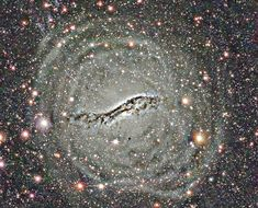 The Outer Shells of Centaurus A (July 1 2012)  Image Credit: E. Peng and H. Ford (JHU), K. Freeman (ANU), R. White (STScI), CTIO, NOAO, NSF What causes the surrounding shells in peculiar galaxy Cen A? In 2002 a fascinating image of peculiar galaxy Centaurus A was released, processed to highlight a faint blue arc indicating an ongoing collision with a smaller galaxy. Another interesting feature of Cen A, however, is the surrounding system of shells, better visible here (...) #astronomy #space