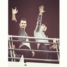 Kevin and Joe waving to fans after the #JBPressConference in Mexico. January 23, 2013. Photo by teamkevinjoenick