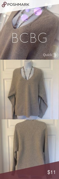 BCBG Long Sleeve Sweater BCBG super warm and cute long sleeve sweater in very good pre owned condition!tagged a size XS but this sweater runs bigger. Hand wash cycle, or dry clean. No stains, holes or snags. BCBG Sweaters