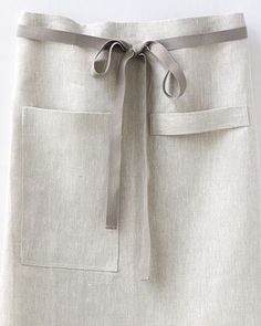 Our Bistro Apron was inspired by men who love to cook, but fits both women and men comfortably. It's long and wide, Oatmeal linen, incredibly sturdy. Made in San Francisco. Cool Aprons, Aprons For Men, Restaurant Aprons, Restaurant Design, Bistro Kitchen, Chef Kitchen, Cafe Apron, Waist Apron, Leather Apron