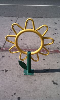 Sunflower bike rack, good for locking bikes of all sizes. Click image to enlarge and visit the Slow Ottawa 'Nice Racks' board for more great designs.