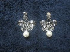 Handmade Silver ear ring with Pearls . Named : Butterfly Hope.
