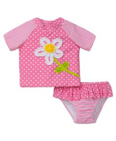 Shield your baby girl from the sun with this darling daisy dot swimsuit featuring built-in sun protection and quick-drying properties. Includes short-sleeve rashguard and ruffled bottom.