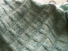 From the pattern description: Of course this blanket can be knit in any color you please, but bright yellow brings an extra spark of joy and light. A pretty textured pattern makes it even livelier. The more you wash this yarn, the softer it gets.