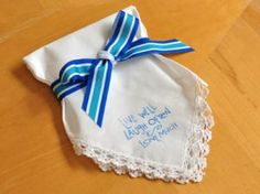 """Personalized Stamped Wedding Hankie Favor DIY. Super easy to make. I used a """"Live Well, Laugh Often, Love Much"""" stamp found at my local craft store. You can make it even more custom by ordering a custom stamp for your handkerchief favor. The possibilities are endless....think personalized bride/groom wedding date hankie, save the date hanky, or tears of joy handkerchief. bumblebeelinens.com"""