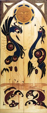 Closet doors.   Herons' Mating Dance Beneath the Full Moon.  Doors designed and carved by Herb Rice.