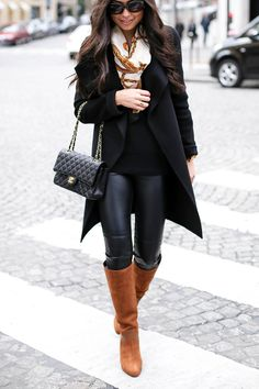 Kat Tanita of With Love From Kat wears a Joseph black winter wool coat, Sergio Rossie brown suede boots, vintage Hermes scarf, and Chanel 2.55 bag in Paris.