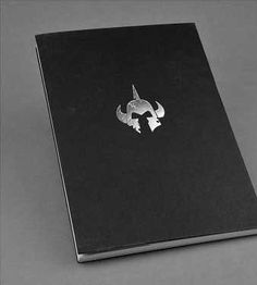 Attention Summoners! This League of Legends journal is a perfect addition to your collection! This fantastic new item features a black paperback exterior and silver font displaying the League of Legen
