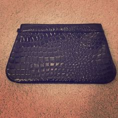 Black Clutch Large, Black clutch from Express. I've used it many of times so there are marks on the inside but nothing is torn. The outside of the clutch looks new and there is a small compartment inside that closes with a zipper. Express Bags Clutches & Wristlets