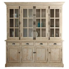 Handcrafted from distressed pine wood with a classic white wash finish, this country-chic cabinet is perfect for highlighting heirloom serveware or treasured...