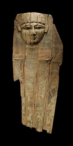 An Egyptian wood sarcophagus section Ptolemaic Period, circa 332-30 B.C.