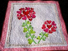 Perfect Valentine quilt.  I wonder if this could be made with the Accuquilt heart die?