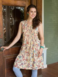 The Evie dress is blessed with one of our remarkable prints where flowers powered by magic take root and bloom on a ground of ancient parchment. A flattering degage neckline holds the secrets, while tiny pleats on the bodice create depth and texture. A perfect knee length dress for a girl with a pocketful of pixie dust.