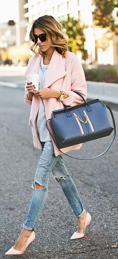 Christine Andrew is wearing a blush pink coat from Lovers + Friends and the matching shoes are from Kurt geiger