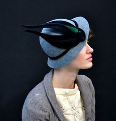 Fedora in flight. via etsy #millinery. Love that it looks like a bird is just perched there on the hat.