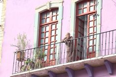 The Woman of the Balcony  Photo by Abraham Venegas -- National Geographic Your Shot