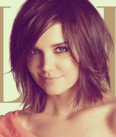 Hairstyle for Round Faces: Short Bob with Bangs. Side swept bangs will draw attention to your eyes, highlighting them and drawing attention away from the roundness of your face. #KatieHolmes