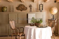In the dining room the antique lockers along the wall were salvaged from an old hotel ~ Charente-Maritime France