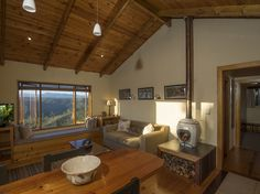 Another angle of the lounge at Cliffhanger Cottage, with fireplace and free firewood.