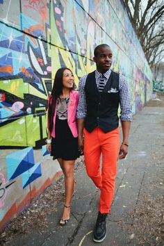 interracial couple, black and asian couple, pink blazer, colourful outfits, animal print dress, blue gingham shirt, mens orange pants, spring outfits