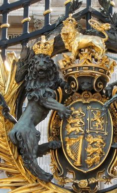 Main Gate of Buckingham Palace in London, England.  The three lions are England, the lion rampant is Scotland and the harp is Ireland.  And once again, the UK leaves out Wales.  Could've easily put in a dragon instead of the second triple lions, but nooo.