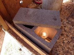 Clever cinder block water heater to keep chicken's water from freezing in winter