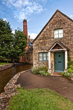 Cottage and old water mill at Lower Slaughter, Cotswold, England