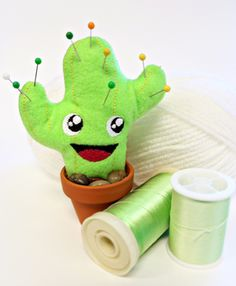 Holy cactus awesomesauce!  What a great pin cushion.  Includes the pattern to make him. #sewing