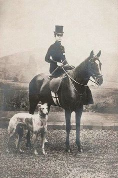 Woman riding side-saddle accompanied by her Borzoi - photographer unknown