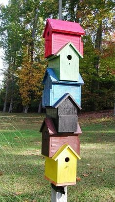 We have creative gatherer squirrels, but these more deeply designed houses with high small entrances might maintain bird family integrity from such marauders.  Each house could be designed with a slanted stick from floor to door so that fledglings can easily climb to the doorways.  --  (handmade wooden bird house design ideas, yard decorations from recycling wood)